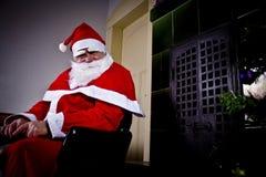 Santa Claus. Is sitting near a chimney Stock Photos
