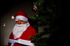 Santa Claus. Is sitting near a chimney Royalty Free Stock Images