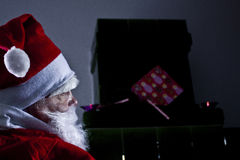 Santa Claus. Is sitting near a chimney Stock Image