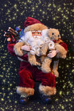 Santa claus. With many gifts Royalty Free Stock Photos