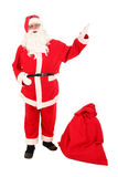 Santa Claus. And his bag of Christmas gifts Stock Photography