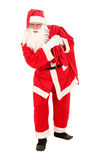 Santa Claus. Carrying bag of Christmas gifts Stock Image
