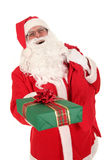 Santa Claus. Holding Christmas Gift Stock Image