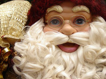 Santa Claus. Doll with presents Stock Photography