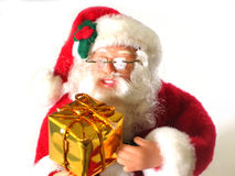 Santa Claus. A Santa doll holding a present Royalty Free Stock Photo