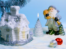 Santa Claus. Compositions with Santa Claus, fabulous house and candle stock image