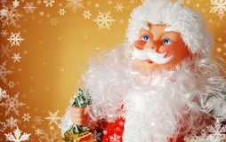 Santa claus. On the gold background with snow royalty free stock images
