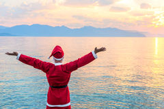 Santa Claus admires the beautiful sunrise Royalty Free Stock Image