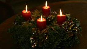 Santa Claus and Advent wreath with burning candles stock video