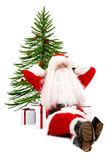 Santa claus against a xmas tre Royalty Free Stock Images