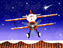 Santa Claus on airplane Stock Images
