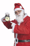 Santa Claus with alarm clock Royalty Free Stock Photos