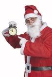 Santa Claus with alarm clock royalty free stock photos