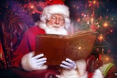Santa claus with album stock images