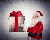 Santa Claus Amazed Holding Stock Photo