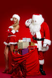 Santa claus and amazing christmas girl Stock Image