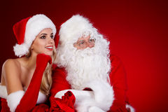 Santa claus and amazing christmas girl Stock Image
