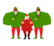 Santa Claus And Elves Bodyguards. Christmas Santa And Guards. Stock Images