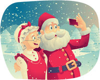 Santa Claus And Mrs. Claus Taking A Photo Together Stock Photo