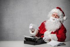 Santa Claus answering his correspondence royalty free stock photos