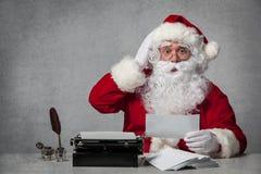 Santa Claus answering his correspondence Stock Photo