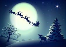 Santa Claus in ar en rendierslee op achtergrond van volle maan in Kerstmis van de nachthemel Royalty-vrije Stock Afbeeldingen