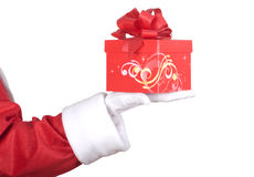 Santa Claus arm with present Royalty Free Stock Photo