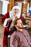 Santa claus as master at barber shop Royalty Free Stock Images