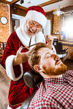 Santa claus as master at barber shop Royalty Free Stock Photography
