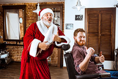 Santa claus as master at barber shop Royalty Free Stock Photos