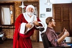 Santa claus as master at barber shop Royalty Free Stock Images