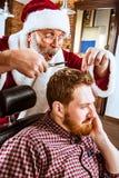 Santa claus as master at barber shop Royalty Free Stock Image