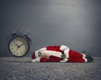 Santa Claus asleep. Concept of tired Santa Claus asleep lying on the ground royalty free stock images