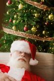Santa Claus, Asleep In Front Of Christmas Tree Stock Photography