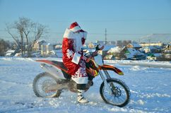 Santa Claus astride on the motocross bike Royalty Free Stock Image