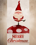 Santa Claus auf pilzartiger Grußkarte Lizenzfreies Stockfoto