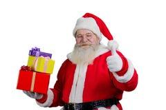 Santa Claus avec des présents, fond blanc Photographie stock