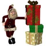 Santa Claus avec la pile des cadeaux de Noël Photo libre de droits