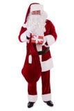 Santa Claus avec le sac et le cadeau Photos stock