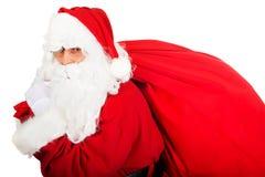 Santa Claus avec le sac plein des présents Images libres de droits