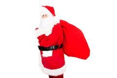 Santa Claus avec le sac plein des présents Photo stock