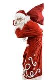 Santa Claus avec un sac des cadeaux Photographie stock libre de droits