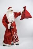 Santa Claus avec un sac des cadeaux Photo stock