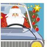 Santa Claus bär en påse med gåvor på maskinen Arkivbild