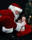 Santa Claus and Baby Stock Photos