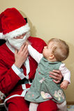 Santa Claus and baby Stock Photos