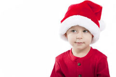 Santa Claus baby boy. Boy wearing santa hat on white isolated background Royalty Free Stock Photos