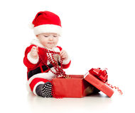 Santa Claus baby boy with gift box  Stock Images