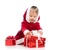 Santa Claus baby girl opening gift box Royalty Free Stock Photos