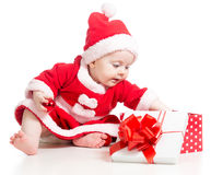 Santa Claus baby girl opening gift box Royalty Free Stock Photo